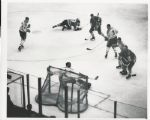 Jacques Plante surrounded by Hawks and Canadiens with Pilote original 1962 photo